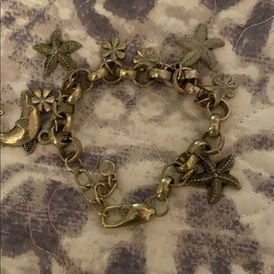 Silver bracelet with charms.